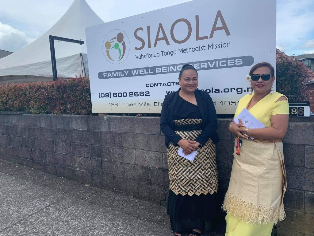 Director and Siaola Sign